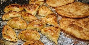 Uzbek national dish samsa, fried dough, puff pastry. Uzbek cuisine. Asian cuisine Stock Images