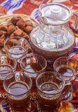 Uzbek national food on traditional fabric adras Stock Photos