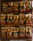 Uzbek paper puppets. Paper puppets chewed by Uzbekistan in a shop of souvenirs of Khiva Royalty Free Stock Photo