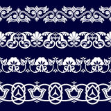 Symmetrical seamless pattern of white cotton ribbon on a blue background in the Uzbek national style Stock Images