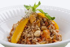 Uzbek pilaf with raisins and nuts royalty free stock images