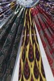 Uzbek silk fabric set. Uzbek silk fabric triangle set up or stack of different raw silk fabrics stock images