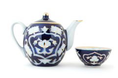 Uzbek Tea Set. Isolated photo of blue Central Asian (Uzbek) tea pot and tea cup (piala) with traditional cotton style pattern Royalty Free Stock Image