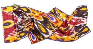 Uzbek tkaniny krajowi adras na białym tle Zdjęcie Royalty Free