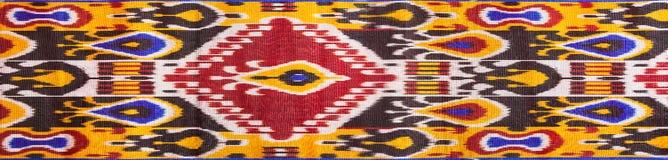 Uzbek tkaniny krajowi adras na białym tle Obraz Royalty Free