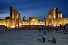 Example of architecture Samarkand, Uzbekistan, Silk Route. The Uzbek tourist with the admiration is examining monuments of Samarkand on the Silk Route, Registon stock images