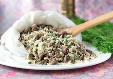 Uzbek traditional dish green pilaf in bag on white plate Stock Photos
