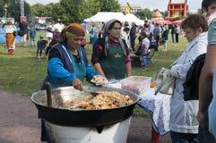 Uzbek women sell pilaf. St. Petersburg. Russia Royalty Free Stock Photo