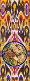 Uzbeka krajowy jedzenie na tradycyjnych tkanin adras Fotografia Royalty Free