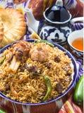 Uzbeka krajowy jedzenie na tradycyjnych tkanin adras Zdjęcia Stock