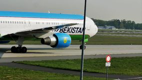 Uzbekistan Airways taxiing in Frankfurt Airport, FRA. Uzbekistan Airways doing taxi in Frankfurt Airport, FRA, Germany stock footage