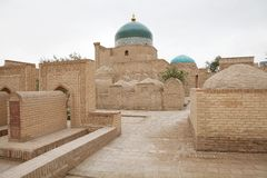 Uzbekistan. Ancient graves in the courtyard of the Madrasah at the Islam Khoja Complex at the Itchan Kala, Khiva, Uzbekistan. Itchan Kala is the walled inner Stock Images