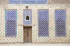 Uzbekistan. Architecture details and finely wooden carved door at Tash Khovli Palace, the summer residence of Khivan Khans, at Itchan Kala, Khiva, Uzbekistan Stock Photography