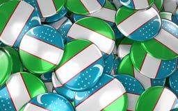 Uzbekistan Badges Background - Pile of Uzbek Flag Buttons. Royalty Free Stock Photos