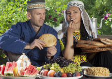 Uzbekistan couple have breakfast with flat cake