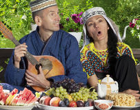 Uzbekistan couple playing mandolin Stock Image