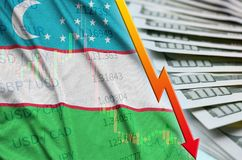 Uzbekistan flag and chart falling US dollar position with a fan of dollar bills. Concept of depreciation value of US dollar currency stock illustration
