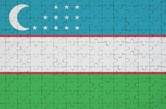 Uzbekistan flag is depicted on a folded puzzle royalty free illustration