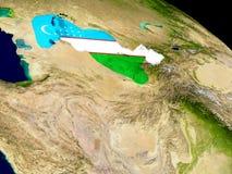 Uzbekistan with flag on Earth Stock Photo