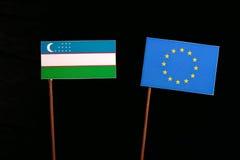 Uzbekistan flag with European Union EU flag  on black Royalty Free Stock Image
