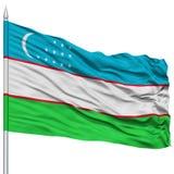 Uzbekistan Flag on Flagpole. Flying in the Wind, Isolated on White Background royalty free stock photo