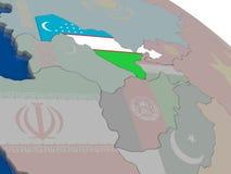 Uzbekistan with flag Stock Photos