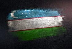 Uzbekistan Flag Made of Metallic Brush Paint on Grunge Dark Wall.  royalty free stock images