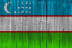 Uzbekistan flag painted on old wood plank. Patriotic background. National flag of Uzbekistan stock photography