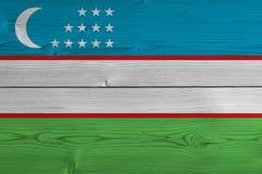 Uzbekistan flag painted on old wood plank. Patriotic background. National flag of Uzbekistan royalty free stock image