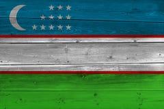 Uzbekistan flag painted on old wood plank. Patriotic background. National flag of Uzbekistan stock images