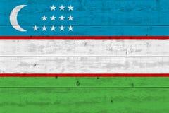 Uzbekistan flag painted on old wood plank. Patriotic background. National flag of Uzbekistan stock photo