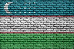 Uzbekistan flag is painted onto an old brick wall royalty free stock photos