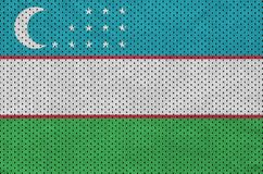 Uzbekistan flag printed on a polyester nylon sportswear mesh fab. Ric with some folds vector illustration