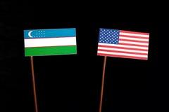 Uzbekistan flag with USA flag on black. Background royalty free stock photography