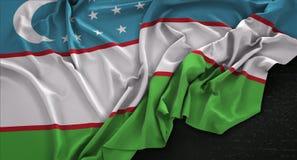 Uzbekistan Flag Wrinkled On Dark Background 3D Render Stock Photo