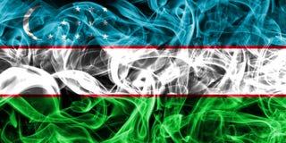 Uzbekistan smoke flag on a black background.  stock image