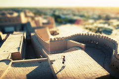 Uzbekistan. Tourist taking pictures on the roof of building in ancient city of Itchan Kala at sunny day, Khiva, Uzbekistan Royalty Free Stock Photography