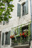 Uzes (France). Uzes (Gard, Languedoc-Roussillon, France) - Old typical house with flowers Stock Photography