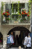 Uzes (France). Uzes (Gard, Languedoc-Roussillon, France) - Old typical house with flowers and shop Stock Photography