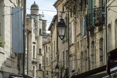 Uzes (France). Uzes (Gard, Languedoc-Roussillon, France) - Old typical street Royalty Free Stock Image