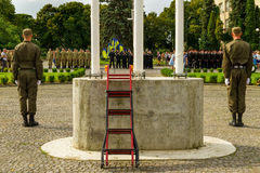 In Uzhgorod celebrated the Day of the State Flag of Ukraine. Uzhgorod, Ukraine - August 23. 2016: A guard of honor near the flagpole during the celebration the stock images