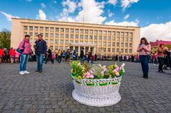 Celebrating Orthodox Easter in Uzhgorod. Uzhgorod, Ukraine - April 07, 2017: Celebrating Orthodox Easter in Uzhgorod on the Narodna square. Huge basket in front Royalty Free Stock Photo