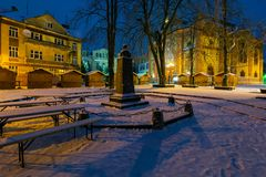 Location for Christmas fair in town. Uzhgorod, Ukraine - DEC 26, 2016: Feczik Park in winter at dawn. former building of synagogue is a popular tourist stock image