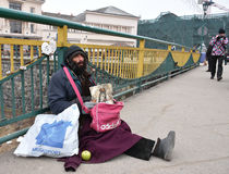 UZHGOROD,UKRAINE - FEBRUARY 16, 2017: Poor man begging for alms Stock Photos