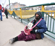UZHGOROD,UKRAINE - FEBRUARY 16, 2017: Poor man begging for alms Royalty Free Stock Photo