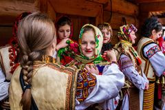 Eighth Ethnic Festival Christmas Carols in the old village. Uzhgorod, Ukraine - January 13, 2018: Female folklore collective performs during the eighth ethnic stock images