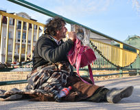 UZHGOROD,UKRAINE - MARCH 04, 2017: Poor man begging for alms in Royalty Free Stock Images