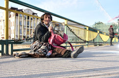 UZHGOROD,UKRAINE - MARCH 04, 2017: Poor man begging for alms in Stock Images