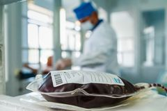 Blood Donation in Ukraine. Uzhgorod, Ukraine - May 10, 2018: Container with blood after blood donation at the blood transfusion station stock images