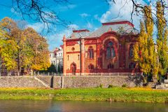 Philharmonic Orchestra Concert Hall of Uzhgorod. Uzhgorod, Ukraine - NOV 10, 2012: Philharmonic Orchestra Concert Hall on the bank of the river Uzh in autumn royalty free stock photography